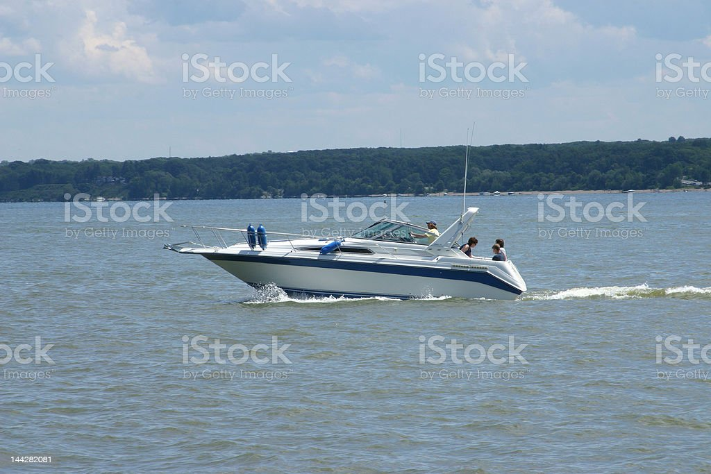 Family on a sport boat stock photo