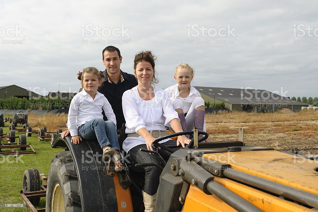 Family on a tractor royalty-free stock photo