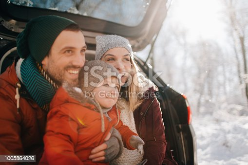 Portrait of a young family getting ready for a winter road trip