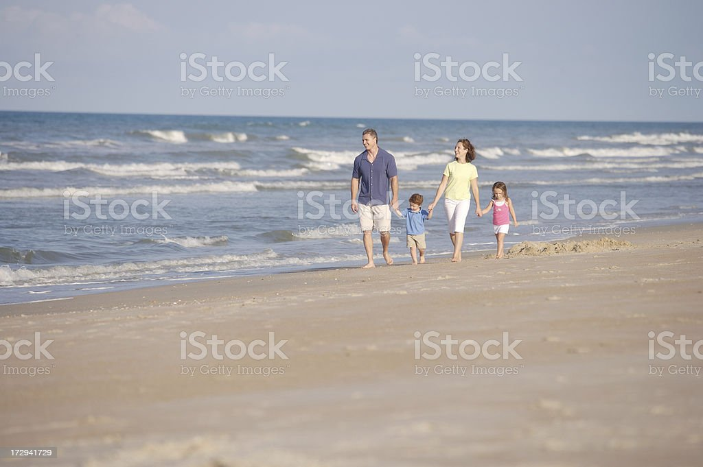 Family on beach (room for text) royalty-free stock photo