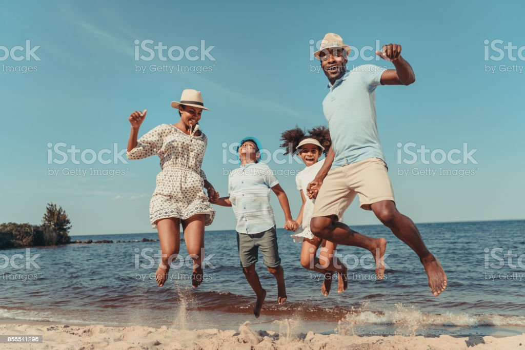 family on beach stock photo