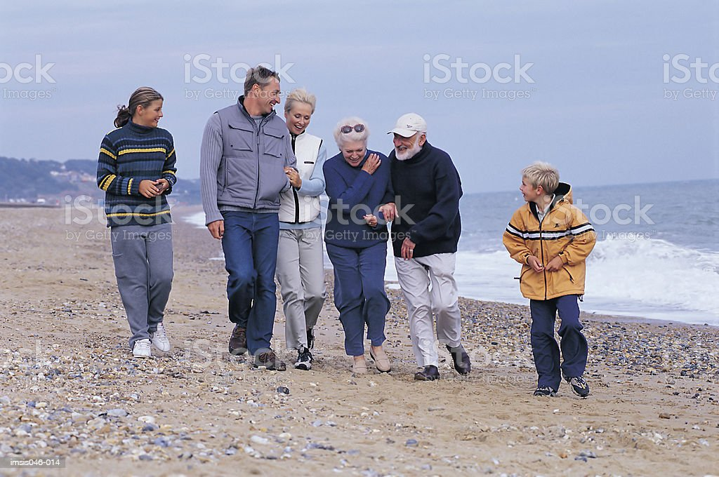 Family on beach royalty free stockfoto