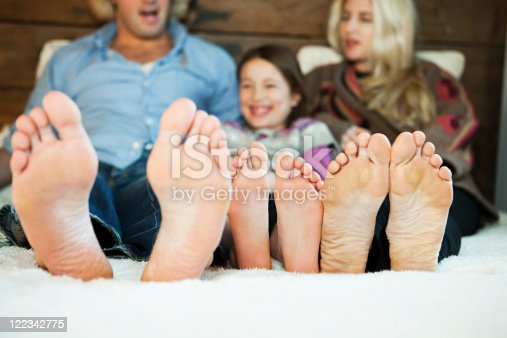 istock Family on bed with barefeet 122342775