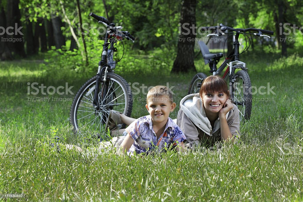 family on bike cycling in park royalty-free stock photo