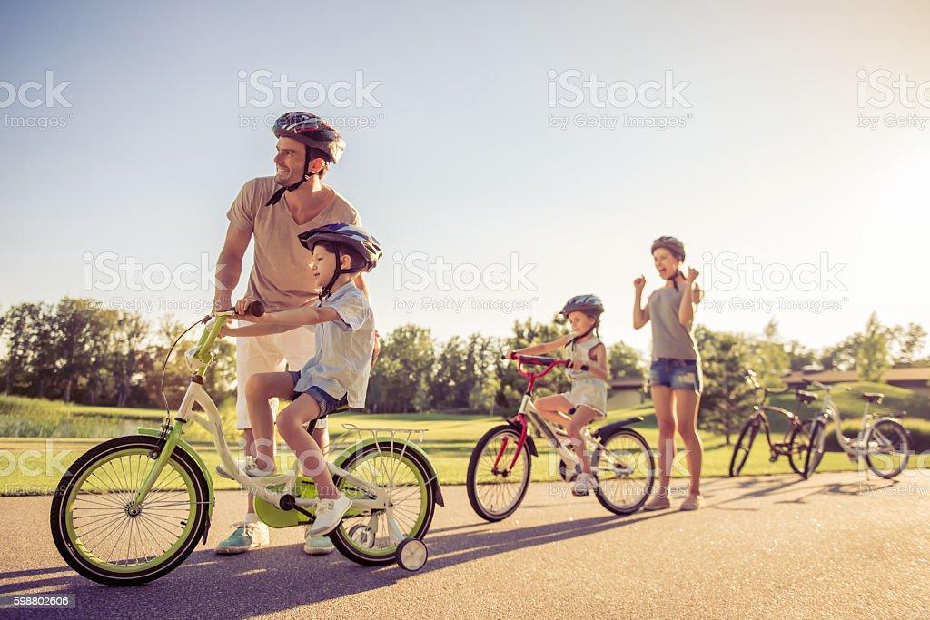 Family on bikes stock photo