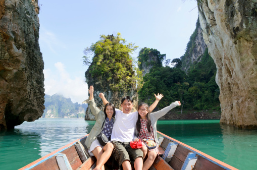 Family On Boat In Khao Sok National Park Thailand Stock Photo - Download Image Now
