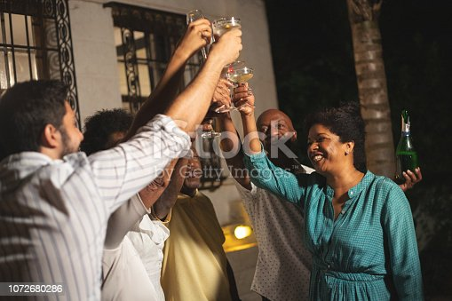 istock Family on Celebratory Toast of Happy New Year at Home 1072680286