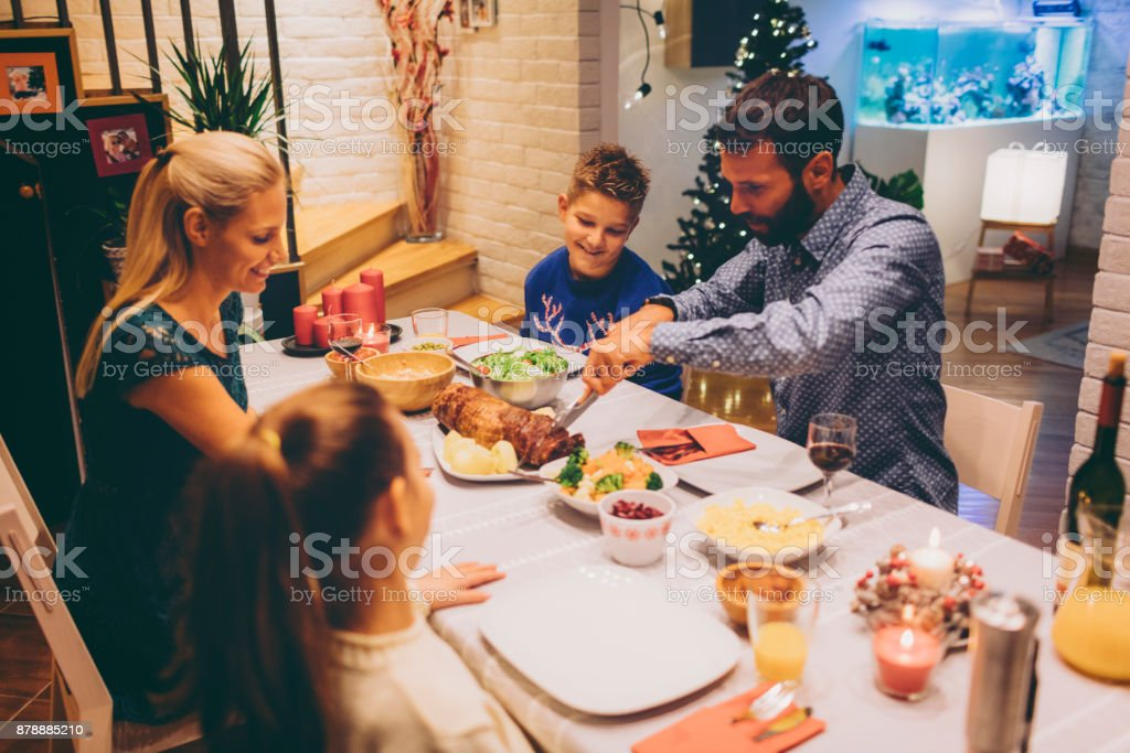 Family On Christmas Dinner At Home stock photo