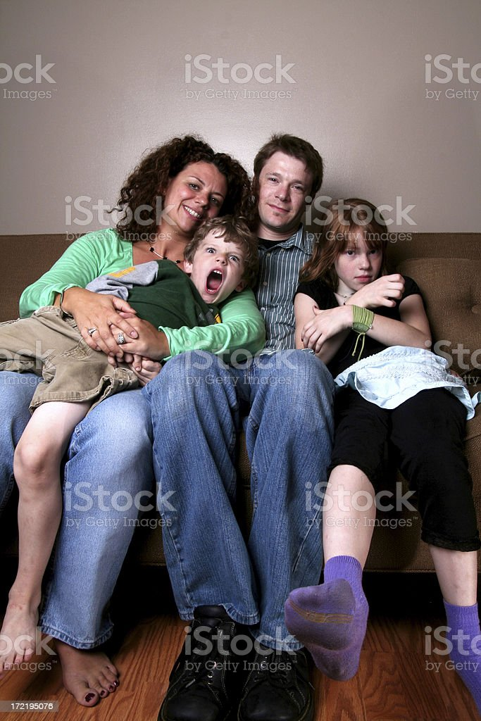family on couch royalty-free stock photo