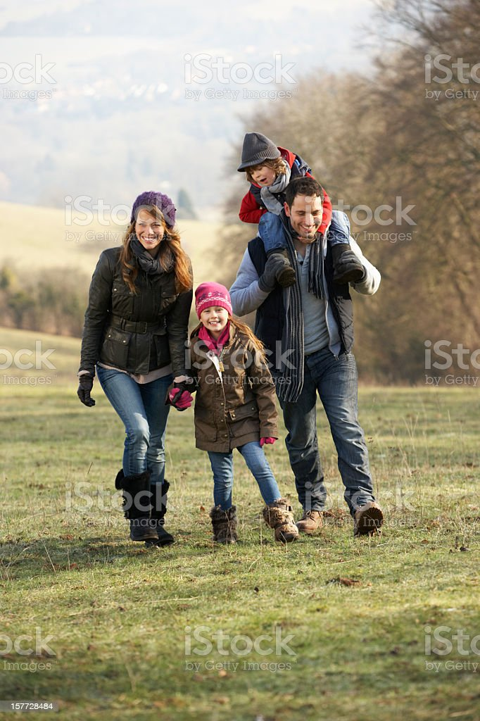 Family on country walk in winter royalty-free stock photo