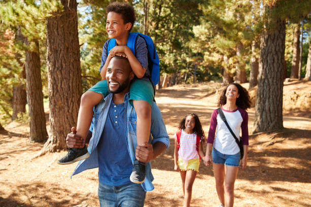 Family On Hiking Adventure Through Forest stock photo