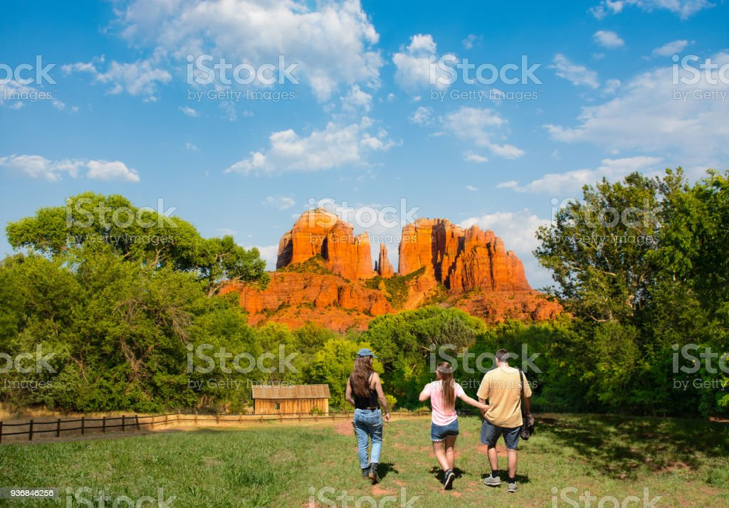 Family on hiking trip enjoying view of  Cathedral Rock. stock photo