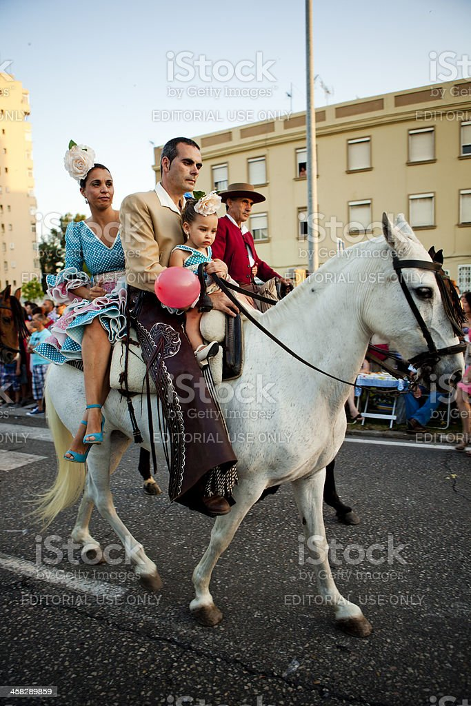 Family on Horseback in Andalusian Spring Parade royalty-free stock photo