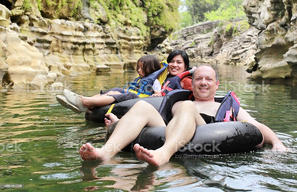 family on inflatable tube stock photo