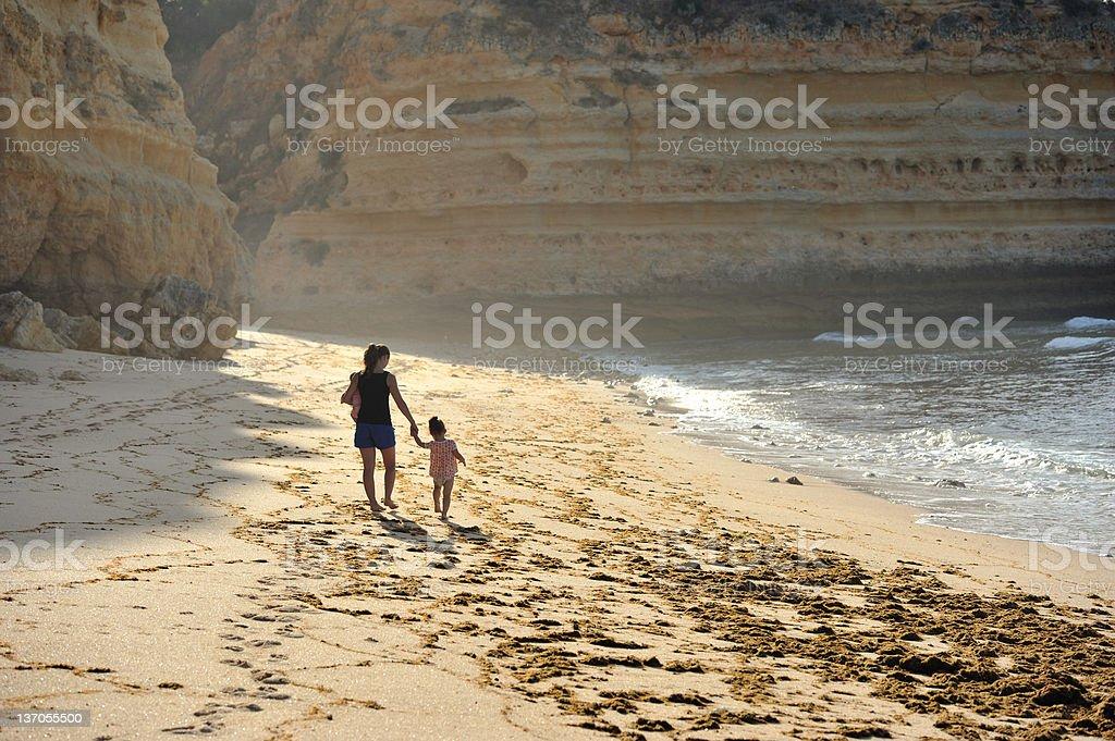 Family on Marinha Beach royalty-free stock photo