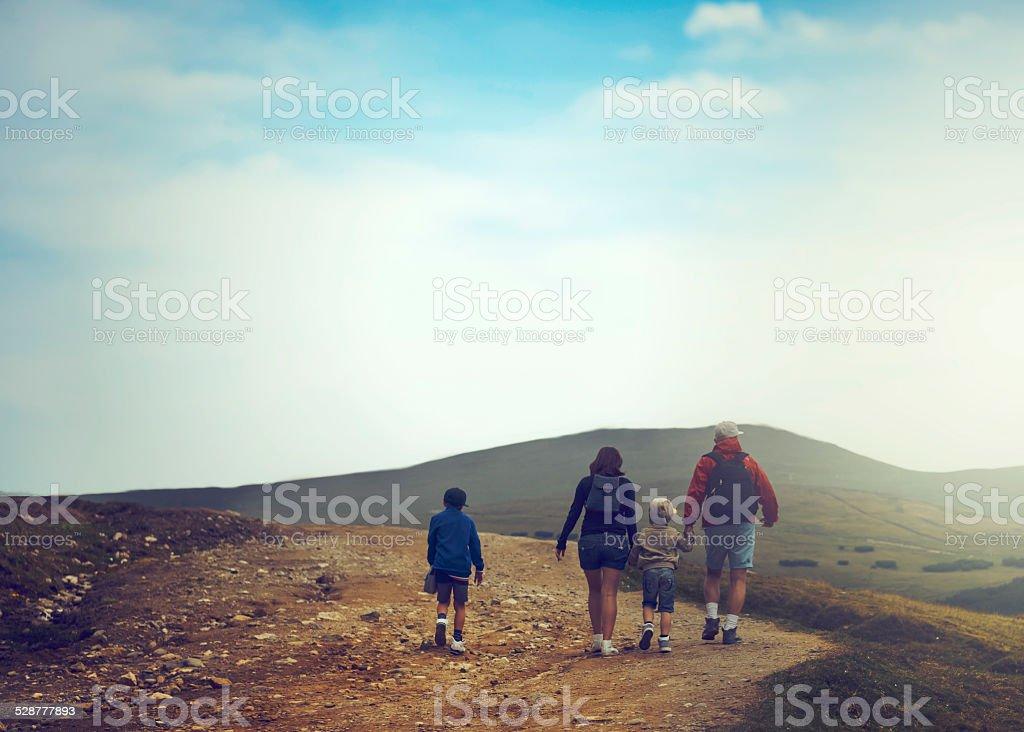 family on mountain trip stock photo