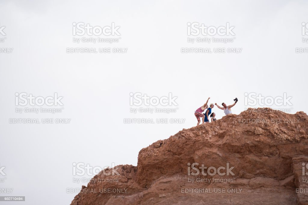 Family on mountaintop. Taking selfie. Moon Valley. stock photo