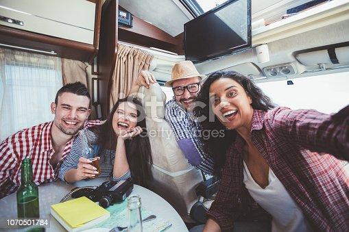 807410214istockphoto Family on roadtrip with campervan taking selfie 1070501784