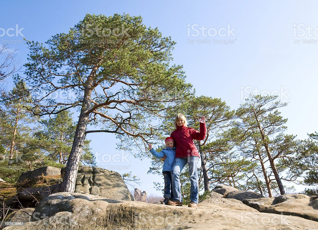 Family on rock royalty-free stock photo