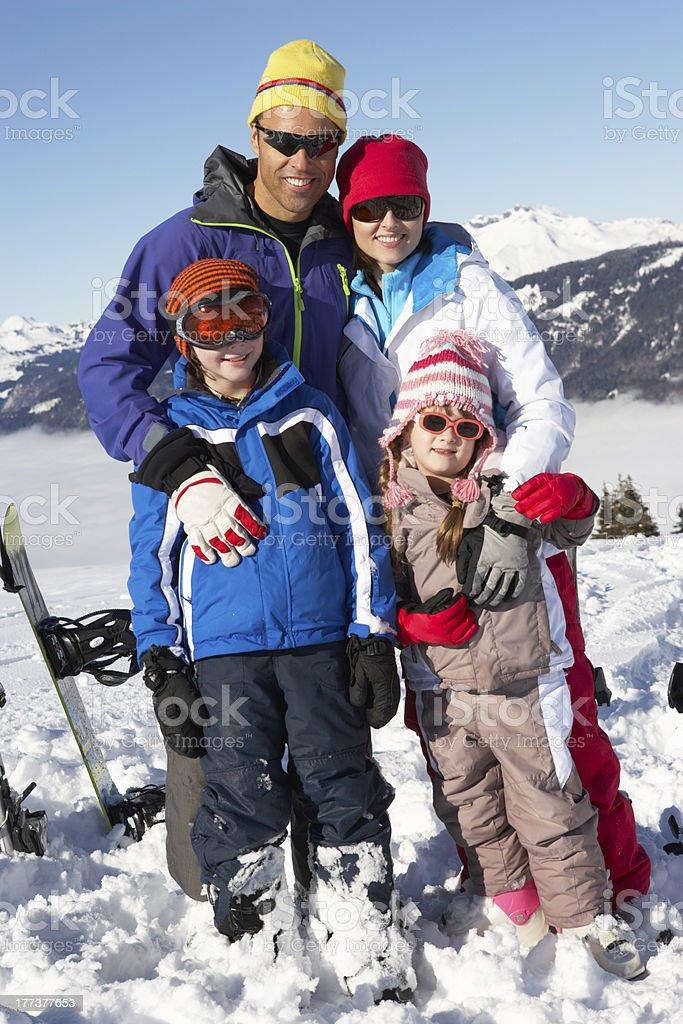 Family On Ski Holiday In Mountains royalty-free stock photo