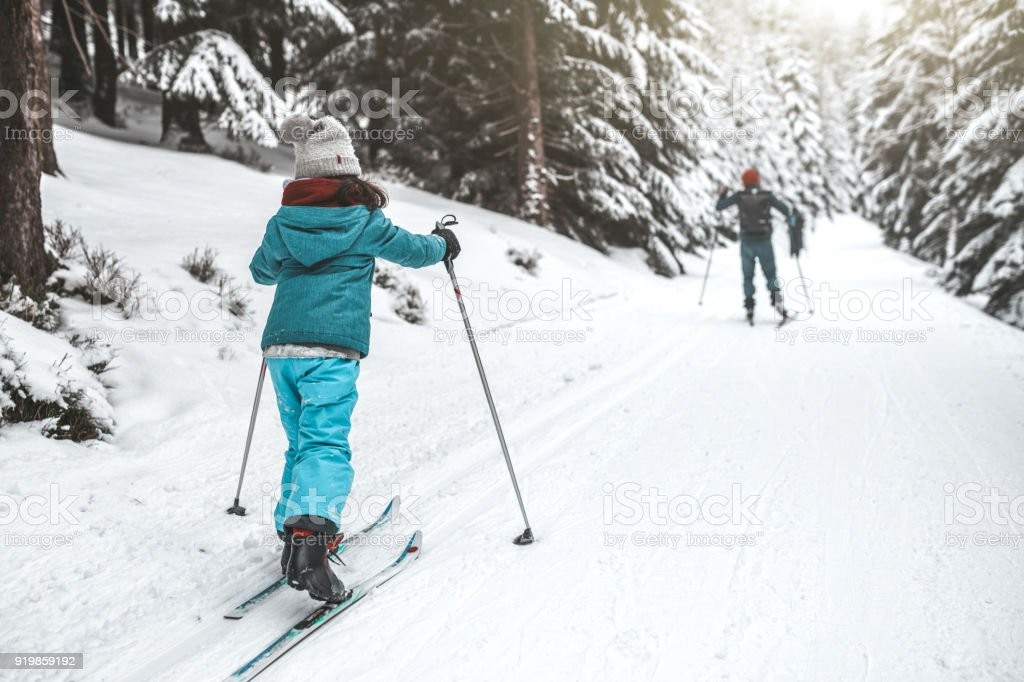family on ski in the snowy forrest stock photo