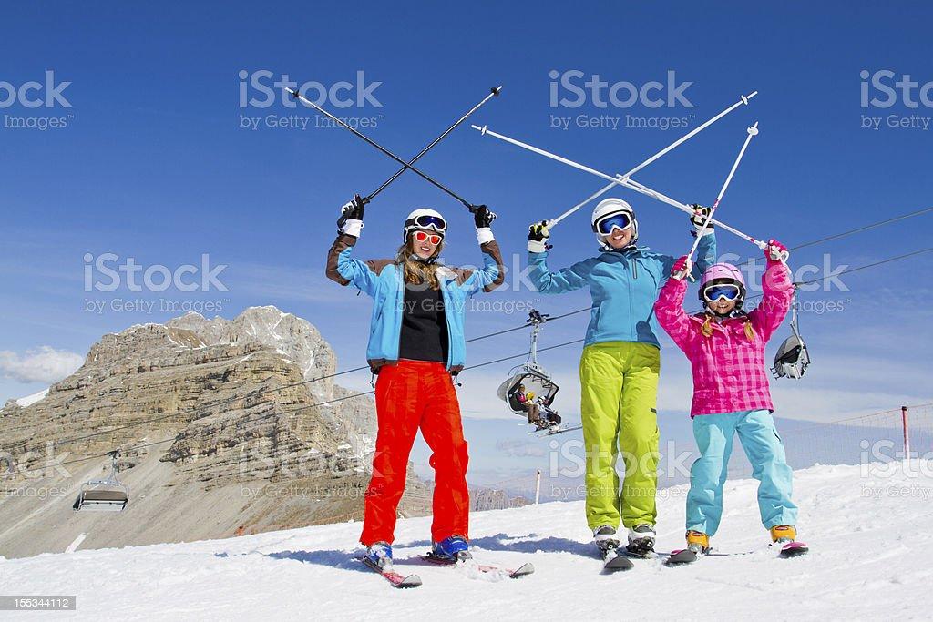 Family on ski slope stock photo