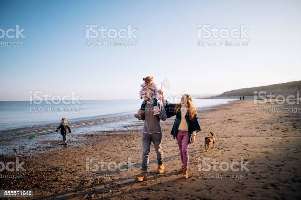 Family on the beach during winter picture id855521640?b=1&k=6&m=855521640&s=612x612&h=mep5khnmayhe wvwo zjg7becebewcxrxarntabhtu4=