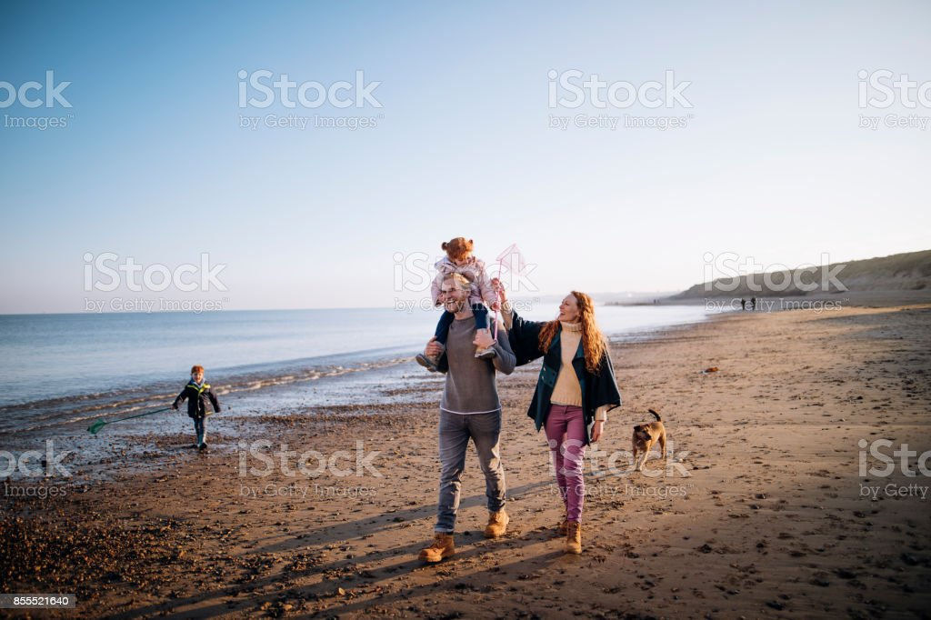 Family on the Beach During Winter stock photo