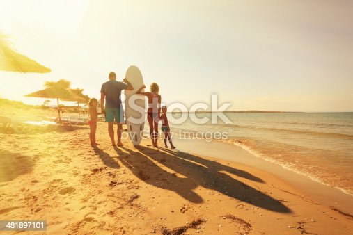 family on the beach - surfboard