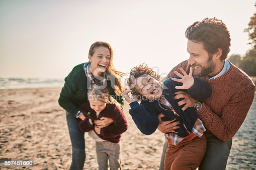 istock Family on the beach 857481660