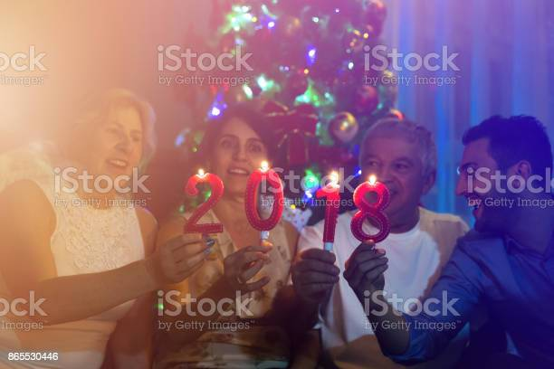 Family on the living room celebrating the New Year 2018