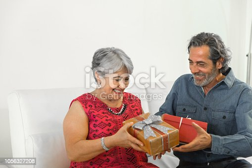 istock Family on the living room exchancing christmas presents 1056327208