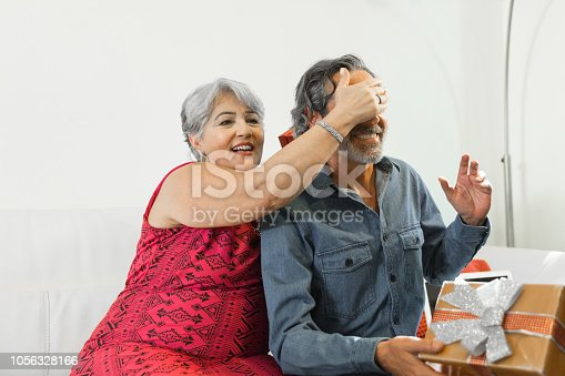 istock Family on the living room exchancing christmas presents 1056328166