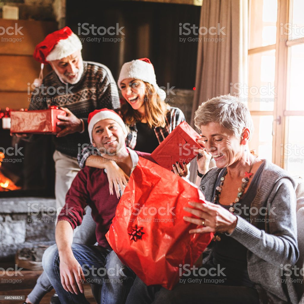 family on the living room for christmas stock photo