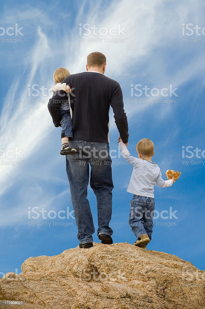 Family on the rocks royalty-free stock photo