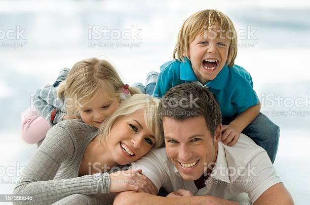 Family On Thr Floor Stock Photo - Download Image Now
