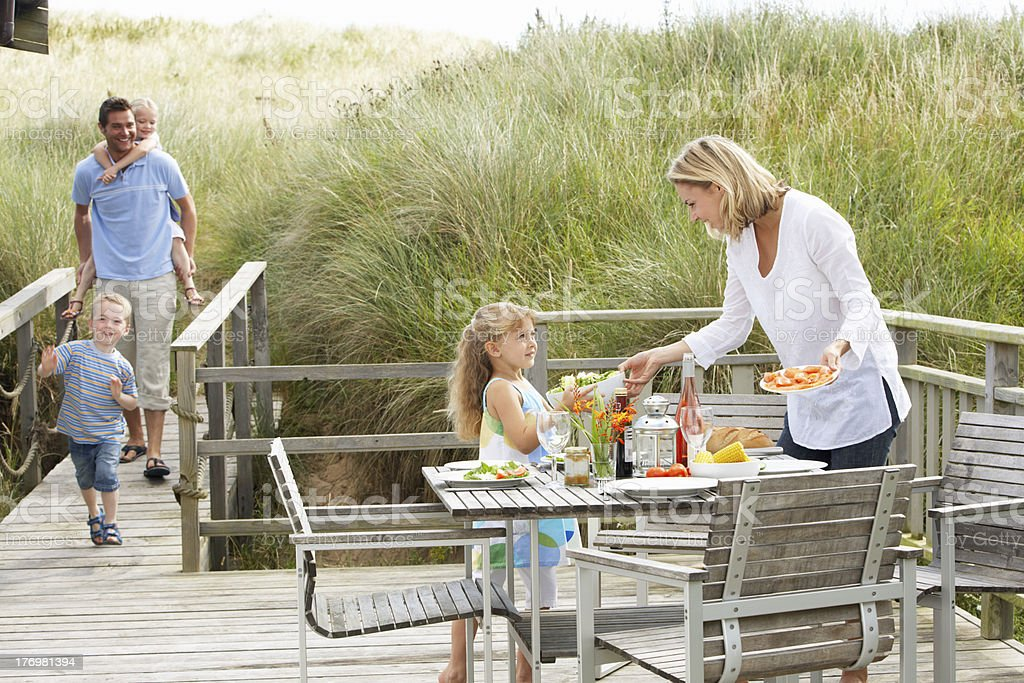 Family on vacation eating outdoors royalty-free stock photo