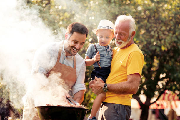 Family on vacation having barbecue party stock photo