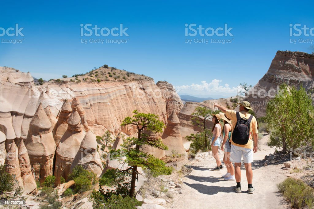 Family on vacation hiking trip in beautiful mountains. stock photo