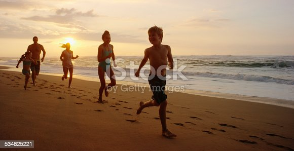 istock Family on vacation spending time at the beach 534825221