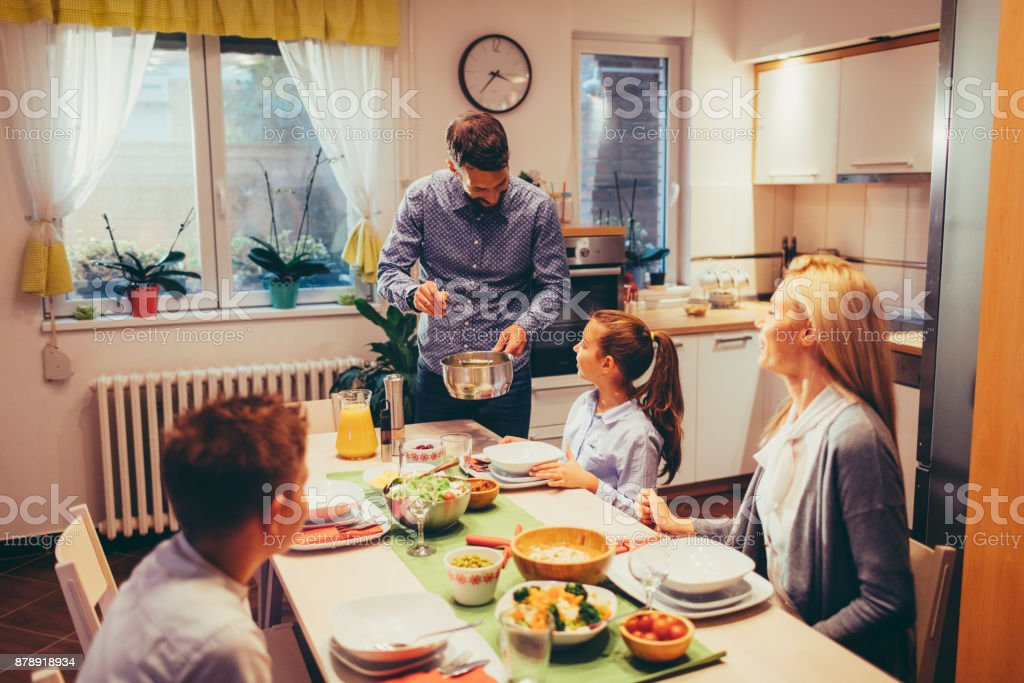 Family On Weekend Luch At Home stock photo