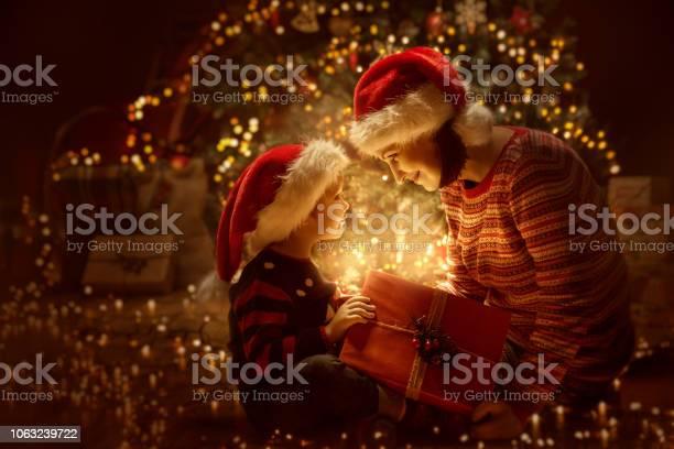 Family open christmas lighting present gift xmas tree and happy baby picture id1063239722?b=1&k=6&m=1063239722&s=612x612&h=j5rkxfx9sssjy7qslax4ejedqalljr3r 84xfohqgfm=