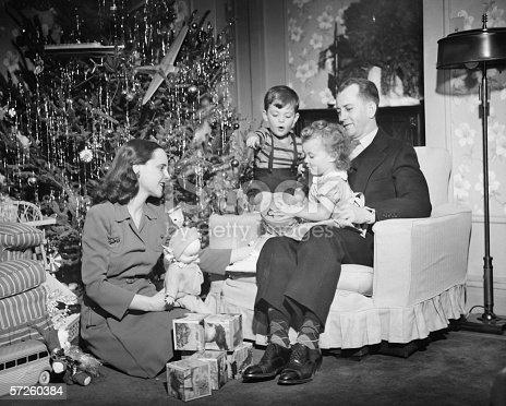 57520540 istock photo Family opening Christmas presents, children (2-3) (4-5), (B&W) 57260384