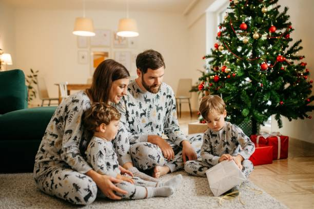Family opening christmas presents stock photo