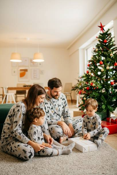 Family opening christmas presents together stock photo