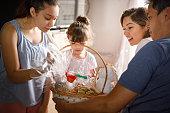 istock Family opening easter basket 1300136766