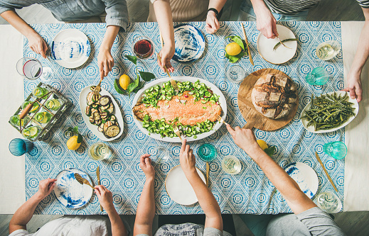 Family or friends having seafood summer dinner