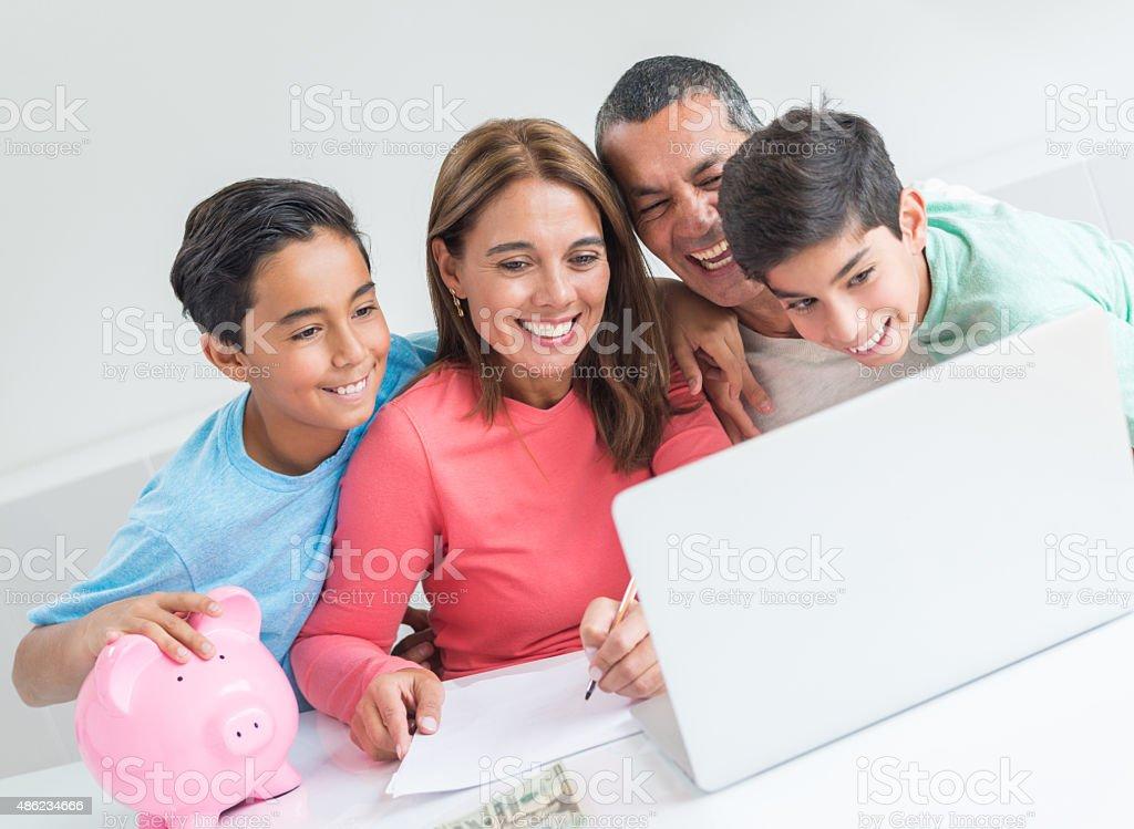 Family organizing their home finances stock photo