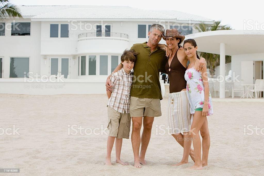 Family outside beach house royalty-free stock photo