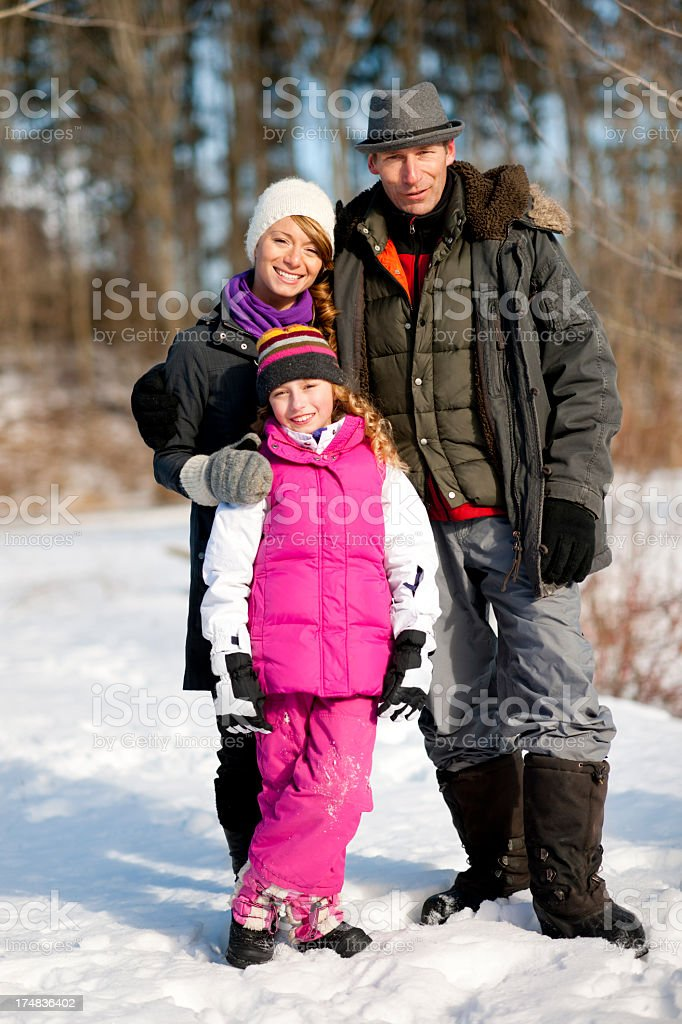 Family outside in the snow royalty-free stock photo